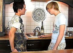 Two young amateurs playing each others cock in the kitchen!